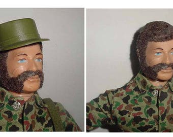GI Joe - Hasbro GI Joe - 1960 s Era -with Camouflage Uniform - Holstered Gun - Hat - Shoes + Shoulder Pack