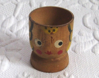Vintage wood egg cup. egg cup . wood egg cup . painted wood egg cup . girl head egg cup