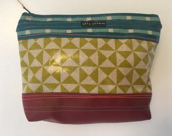Small bag in laminated cotton