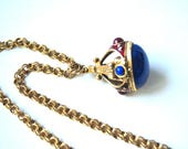 Victorian vintage 70s, gold tone metal, necklace with a chunky , long chain and large crown, heavy pendant.Unsigned Goldette.