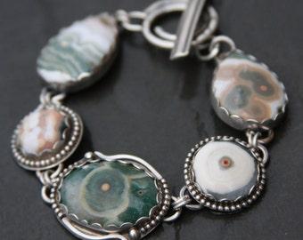 ocean jasper and sterling silver metalwork link bracelet