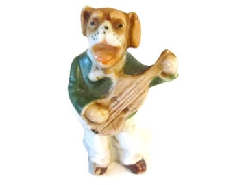 Hand painted porcelain bisque figurine - Germany - Dog singing and playing guitar