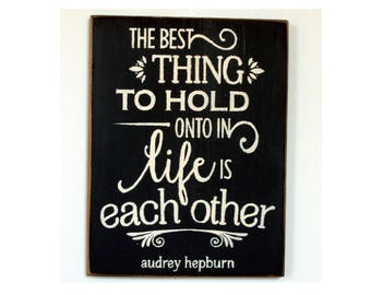 The best thing to hold onto in life i eachother wood sign