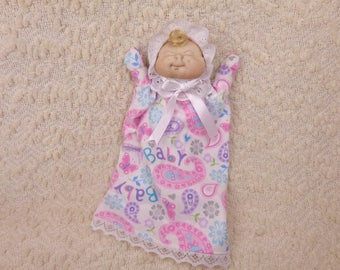 Soft sculptured baby doll puppet