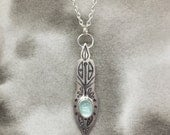 Íss icicle etched sterling silver and aquamarine pendant with swirling botanical design, a perfect holiday or anniversary gift