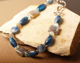 Deep sea blues bracelet featuring apatite, kyanite, labradorite, blue topaz and sterling silver
