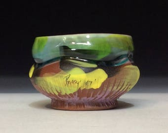 Colorful teabowl with glazed top and matte bottom