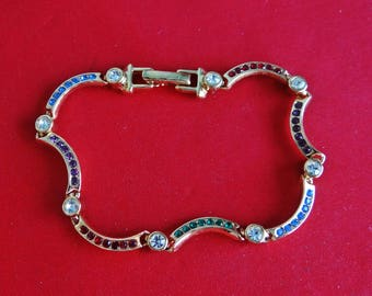 """Vintage gold tone 7.5"""" bracelet with colorful rhinestones in great condition, appears unworn"""