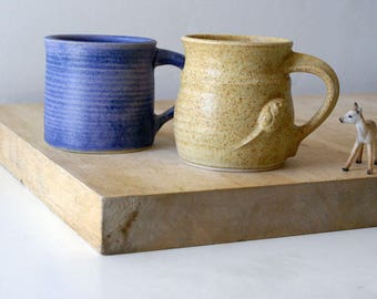 Two mismatched mugs - glazed in lavender blue and natural brown