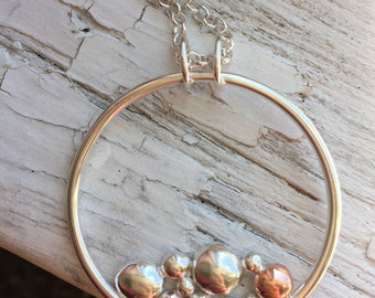 Copper and silver circle pendant