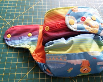 Up up and away ,   one size pocket diaper AWJ lined, organic bamboo insert