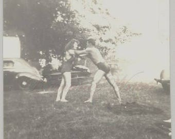 Playing Around Vintage Photo of a Man and Woman Playing Around