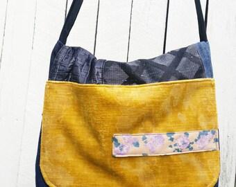 Messenger Bag, denim and upholstery fabric. Pocketbook. School bag. Cross body strap. Hand bag. Ipad. Upcycled. Jeans bag. Repurposed.