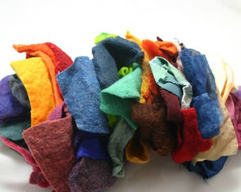 Fabric scraps, handmade wool felt and hand dyed silk and cotton fabrics