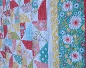 Apple Brights Whirligigs 69x92 quilt in bright, happy colors