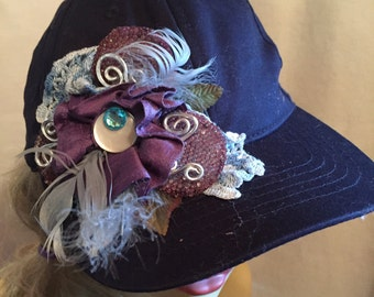 Baseball Cap Navy Blue decorated with A Collage of Blue and Purple Flowers Feathers and Findings