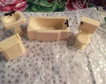 Four piece renewal dollhouse bathroom set