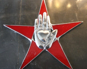Heart in Hand in Star- 10 inch red art glass star with tin milagro hand center