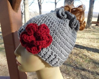 Crocheted Messy Bun/ Ponytail Beanie in Medium Grey  with Detachable Flower in Red