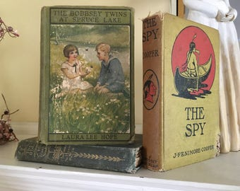 Three decorative antique books