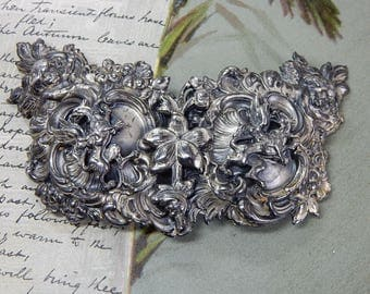 FISHEL NESSLER Signed Silver Baroque Buckle w/ Dragons and Angels     OAH47