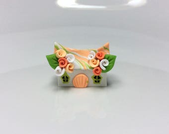 Miniature fairy cottage in green and orange handmade from polymer clay