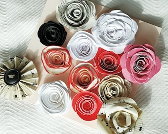 set of 13 miniature tiny paper roses spirals accordion red black and white music scrapbook embellishments