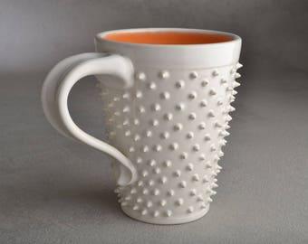 Spiky Mug Ready To Ship White and Pale Orange Dangerously Spiky Mug by Symmetrical Pottery