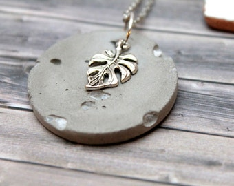 Concrete necklace with metal monstera and natural stones