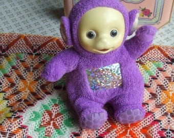 Vintage Tinky Winky From Teletubbies.  In Sitting Position. Used but Washed. Terrycloth Doll with Plastic Face.
