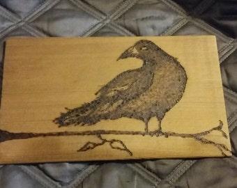 Raven on a branch cedar shingle pyrography portrait