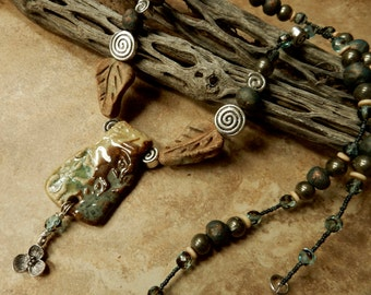 Contemporary earth bound necklace... urban primitive ....At Home In Taos beads and pendant, pyrite, bone,..... truly one of a kind..