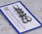 Silver and fresh water pearl earrings hanging from bar with 3 handformed silver flowers