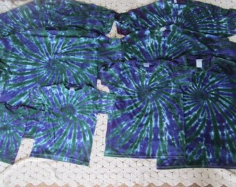 Tie dye shirts in a variety of youth, adult, and plus sizes- Super rad purple & hunter green- Looks as good on the guys as it does the gals!