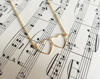 Two hearts necklace in silver or gold
