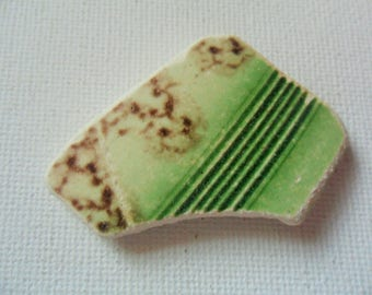 Green and brown beach pottery shard