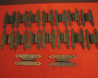 16 incised copper hinges, in two sizes