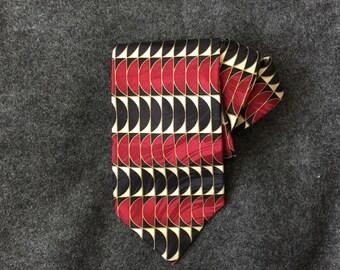 Silk necktie Paris Montreux modernist op art abstract pattern in metallic gold brick red black ivory
