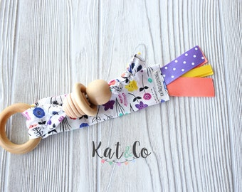 Ready to ship Natural maple teething ring in organic purple floral fabric.  Can be personalized.