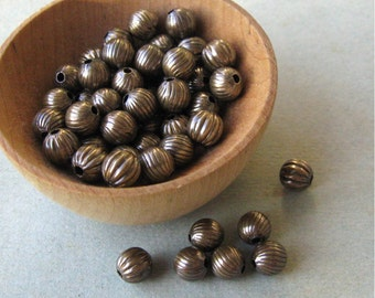 Vintage Oxidized Brass Hollow Round Beads 8mm Corrugated Patterns USA Made (50)