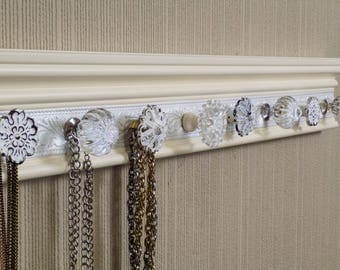 YOU CHOOSE 5,7 or 9 KNOBS Necklace holder.This Wall hung jewelry organizer is off white w/ a shimmery white center.Shabby chic Vintage look