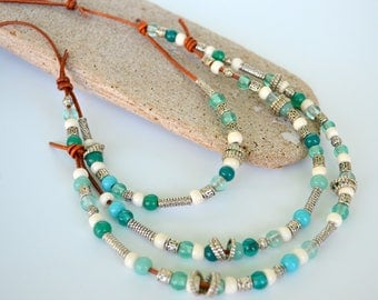 Leather and Bead Triple Strand Necklace, Aqua Glass Beads, White Bone Beads, and Antiqued Pewter Beads on Knotted Natural Brown Dyed Leather