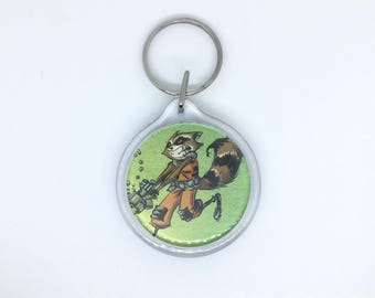 Upcycled Comic Book Keychain Featuring - Rocket Raccoon and Groot