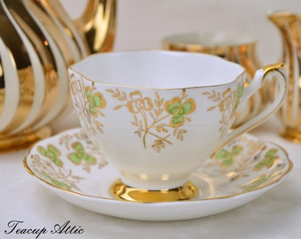 Queen Anne Floral Gold And Green Shamrock Teacup and Saucer, English Bone China Tea Cup Set, Replacement China, ca 1959-1966