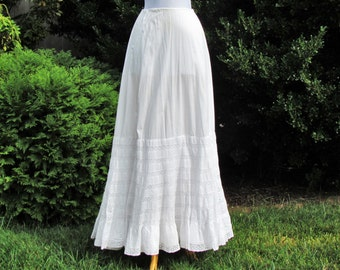 Antique lace trimmed petticoat, c.1900 petticoat with 7 rows of insertion lace and multiple layers of lace trimmed ruffles, small size