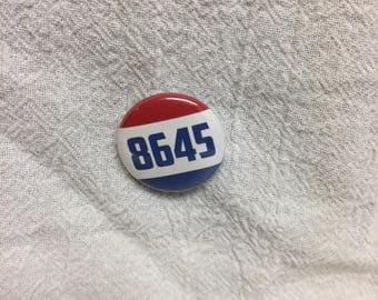 8645 pinback anti Trump 1 inch button
