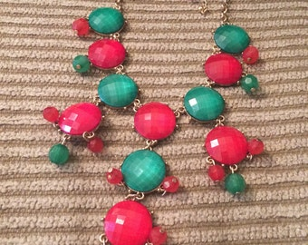 Red and green necklace with earrings
