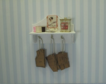 Gaël Miniature Shelves full of accessories and sewing patterns   for French dollhouse in 1:12 scale