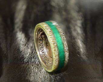 Silver Canada coin ring with deer antler and emerald inlay