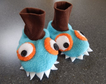 Turquoise and orange monster fleece stay on baby booties